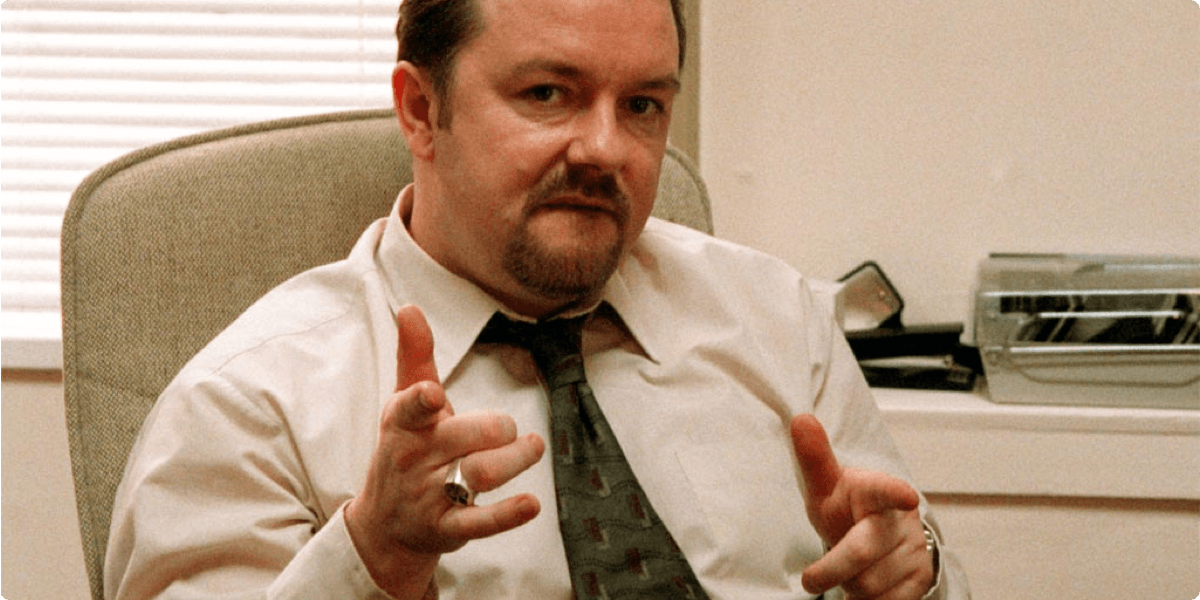 Image showing David Brent of the UK's The Office pulling a 'finger guns' pose
